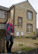 A smiling woman stands in front of her Portland home after a J&M Services gas piping installation